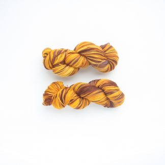 2 Skeins of Creme Caramel Superwash Merino Wool in Aztec Gold, Burnt Orange and Gold Ochre