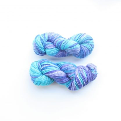 2 skeins of turquoise and violet hand dyed merino yarn
