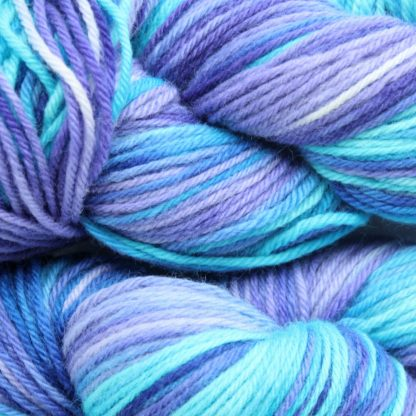 Galaxy Gazing Turquoise and Violet hand dyed merino yarn close up