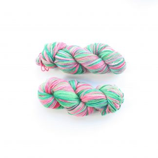 2 skeins of Watermelon Delight hand dyed merino yarn in pink and green