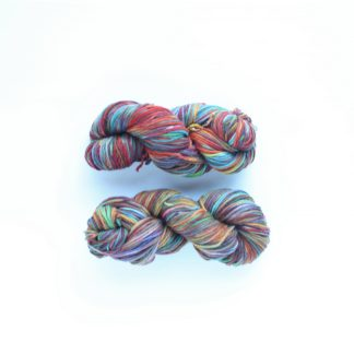 2 skeins of floral garden hand dyed superwash merino yarn in green, violet, pink, brown, turquoise