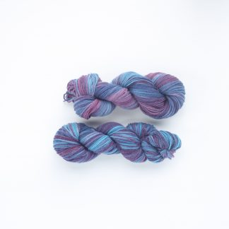 2 skeins of turquoise and mulberry hand dyed merino/angora yarn