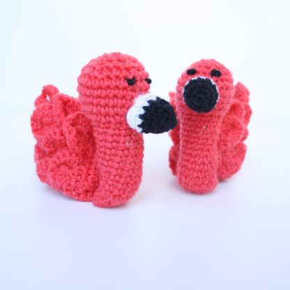 Pair of Newborn Booties in shape of flamingo in coral pink front view
