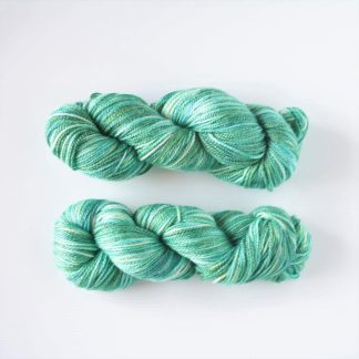 2 skeins of emerald green hand dyed merino/bamboo yarn