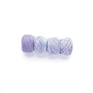 4 balls of Lavender Fields hand dyed organic cotton yarn in shades of lavender