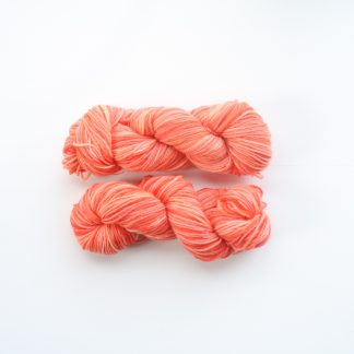 2 skeins of hand dyed merino yarn in peach