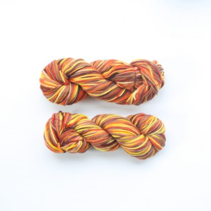 2 skeins of Pilbara Summer hand dyed merino yarn in orange, chestnut and yellow