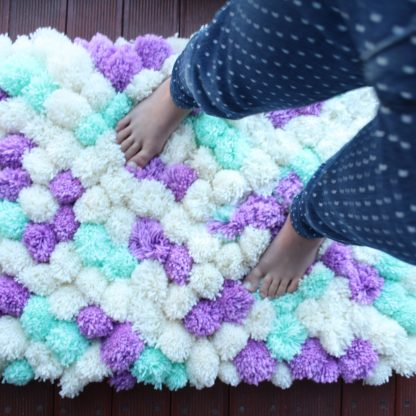 Pom Pom Rug made in mint, purple and cream, 70*90cm