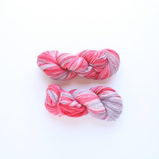 2 skeins of Silver Pink Delight hand dyed merino yarn in silver and pink