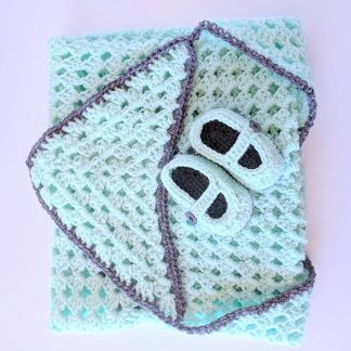 Hooded newborn baby blanket in mint with charcoal trim and matching booties