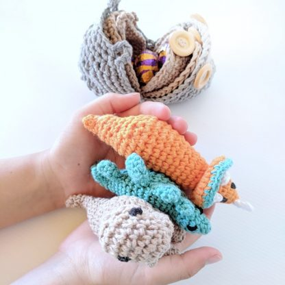 Dinosaur Hatchlings Orange, Teal and Taupe in hands