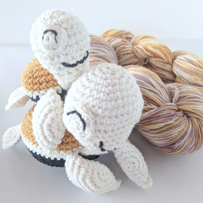 Mother and Baby Turtle in mustard, cream and black, baby sitting on top of mother