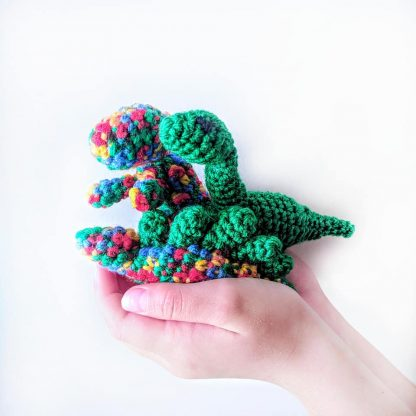 group of 3 small dinosaurs in hands