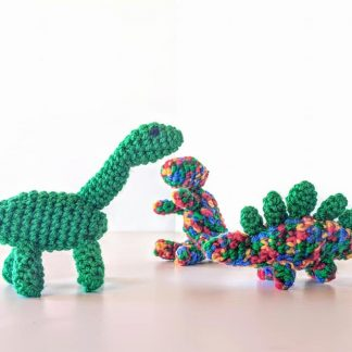 group of 3 small green dinosaurs